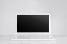 Totally White Laptop With Black Screen. Pure Workspace Concept