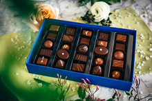 A Box Of Chocolates With Roses