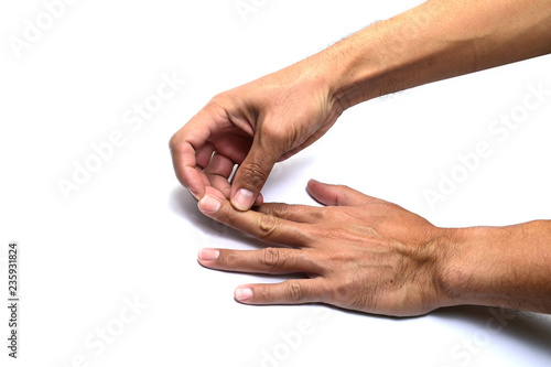 Fotografia, Obraz  the finger of right hand provoking the nail of left hand on white background iso