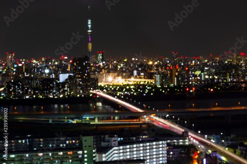 Fotobehang Stad gebouw Blur and bokeh ligh of Tokyo skytree tower in Janpan in night light with brigde and building