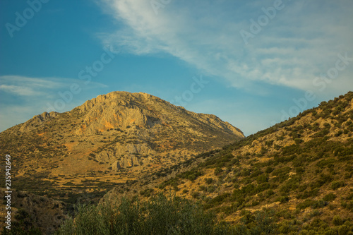 vivid highland mountain scenery landscape on bright blue sky background in clear summer weather day time