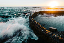 Ocean Waves Crashing Against B...