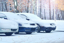 Snow Covered Cars On A Parking Lot. Winter In A City.