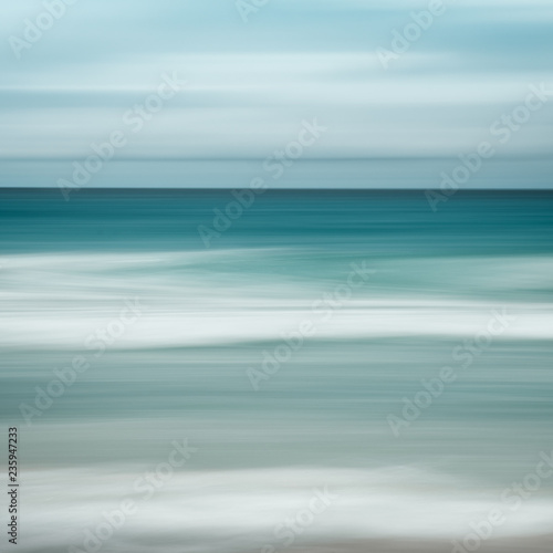 Photo sur Aluminium Bleu clair Empty sea and beach background with copy space, Long exposure, blur motion blue abstract vintage tinted gradient background