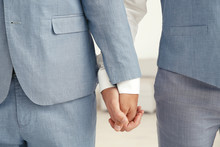 Newlywed Gay Couple Holding Hands At Home, Closeup