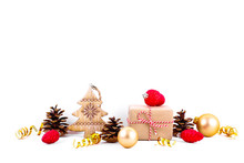 Minimalistic Festive Composition With Presents Wrapped In Craft Paper, Colorful Matte Christmas Balls. Fancy Beautiful Decoration For Christmas Pine Tree. Background, Copy Space, Close Up, Front View.