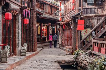 Fototapeta na wymiar On the street of ancient town Shuhe, Lijiang, UNESCO World Heritage Site. Yunnan province, China. Travel Asia.