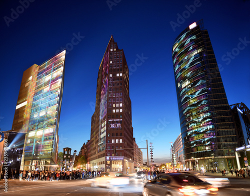 Fotobehang Stad gebouw night view while sundown on the modern highrise buildings and traffic at the Potsdamer Platz in the Berlin city centre, Germany