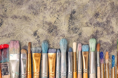 Row of artist paint brushes  on background
