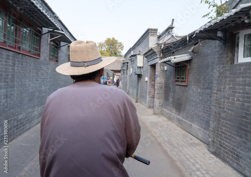 Fotografie, Obraz  Rickshaw operator in Hutong district in Beijing