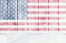 Christmas Winter Background With Wooden Wall, Falling Snow, Snowdrift And American Flag