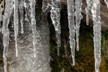 Icicles Of An Overfrozen Spring Dripping Down A Limestone Cliff