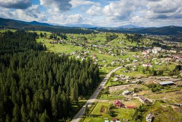 Fototapeta na wymiar Aerial drone photo of highland town in Carpathian mountains