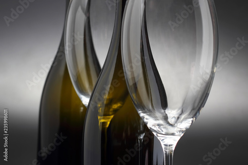 two empty wine glasses and two bottle close-up