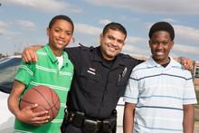 Policeman Talking To Kids On The Street