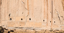 Panorama Of Abandoned Ancient Cliff Dwellings And Caves In A Massive Cliff Face With Adobe Ruins At The Long House In Bandelier National Monument Near Santa Fe, New Mexico