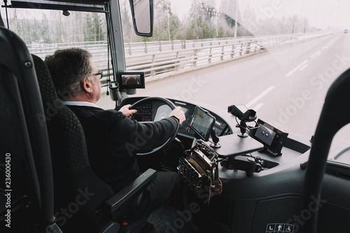 Driver driving a  bus