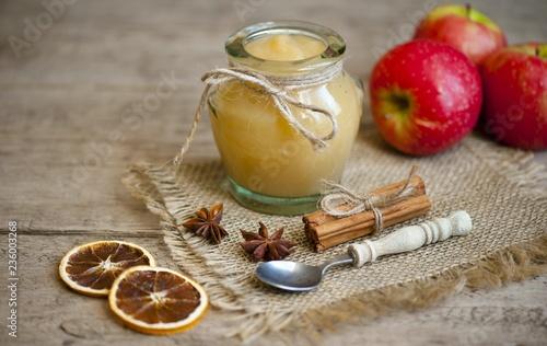 Foto auf AluDibond Lebensmittelgeschäft Old wooden table with fresh made Applesauce (selective focus; close-up shot)