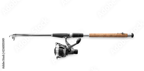 Stampa su Tela Modern fishing rod with reel on white background, top view