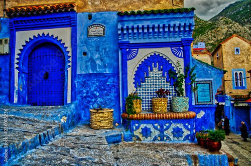 Poster Maroc Street with stairs in Medina of Chefchaouen, Morocco. Chefchaouen or Chaouen is known that the houses in this old town are painted in the striking, variously blue hued