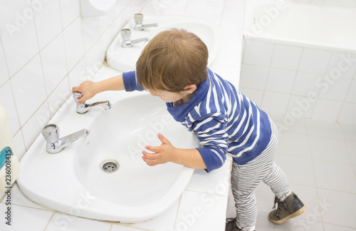3 years boy washing hands at adapted school sink Canvas Print