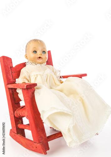 Fotografija  Antique Doll in Folk Art Chair