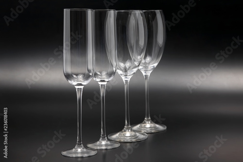 Four wine glasses on a dark background close-up