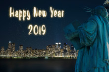 2019 Happy New Year Fireworks Greeting / Back Side Of Statue Of Liberty With Background Of Night View Of New York / Manhattan Over Hudson River.