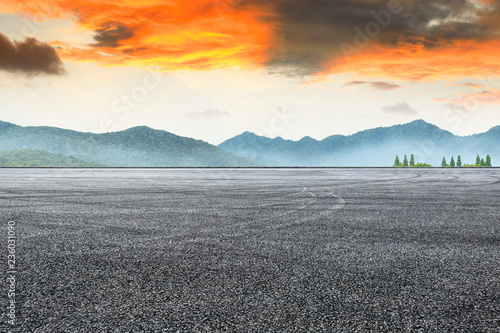 Asphalt road pavement and mountain at beautiful sunset