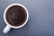 Cup of turkish brewed from whole bean organic smooth medium dark roast coffee from Sumatra on natural stone background.