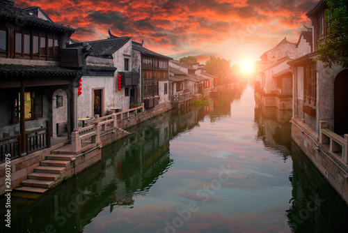Aluminium Prints Theater The reflection of the sun setting over the river in the ancient town of Wuxi, Dangkou