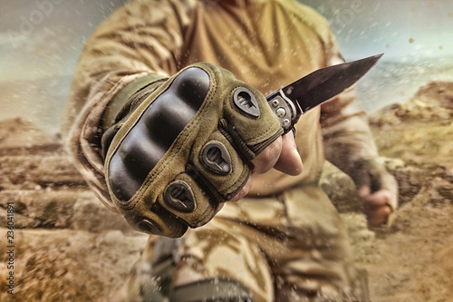 Military soldier holding a ...