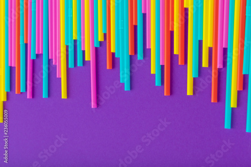 Colorful straws for beverage soft drink on colored background Wallpaper Mural
