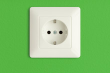 Electrical Socket On Green Wal...