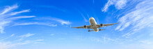 Airplane Flying In The Blue Sky,panoramic View