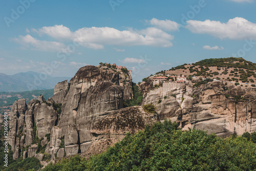 Spoed Foto op Canvas Cappuccino Mountain scenery with Meteora rocks and Roussanou Monastery, landscape place of monasteries on the rock.