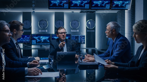 Fototapety, obrazy: Corporate Executives Have a Closed Meeting With the Goverment Officials in the Negotiations Room. Serious Business People Solving Problems.