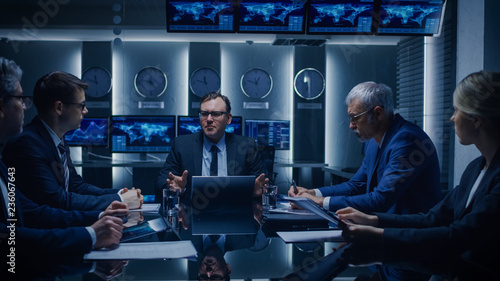 Government Officials, Business Executives Watching Presentation in the Conference Room. Working Projector on the Table. Business People Having Discussion, Negotiating and Solving Problems.