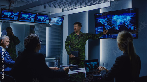 Leinwand Poster High-Ranking Military Man holds a Briefing to a Team of Government Agents and Politicians, Shows Satellite Surveillance Footage