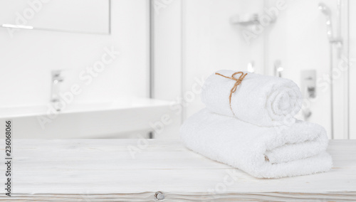 Poster Spa Spa towels on shelf in defocused bathroom with copy space