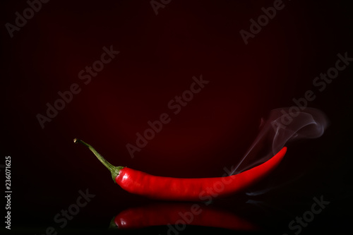 Red hot chili pepper on dark color background
