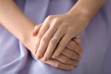 Young Woman With Engagement Ring On Her Finger, Closeup