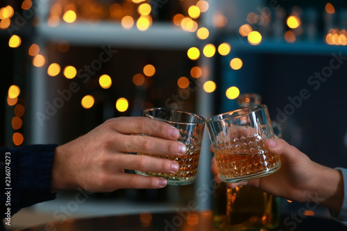 Couple drinking whiskey in bar Canvas Print