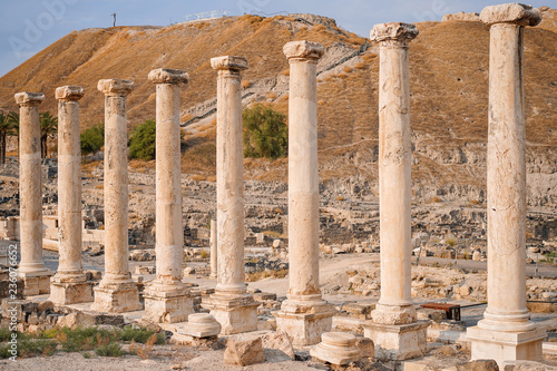 Ruins of the roman period in Beit She'An in Galilee in Israel, the hill on the b Canvas Print