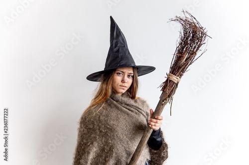 Obraz na plátně A young woman wearing a witch costume