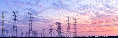 Fotografia high-voltage power lines at sunset,high voltage electric transmission tower