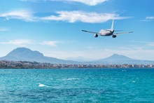 Airplane Flying Over The Sea And Beach. Travel Concept.