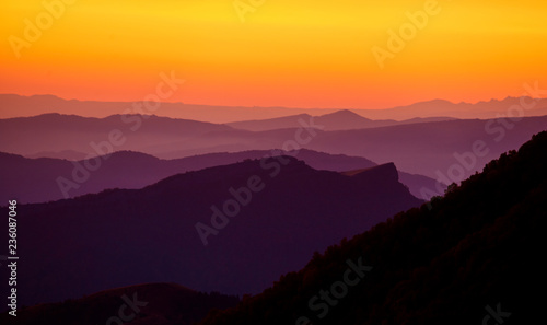 Landscape with mountains and the sun. Sunset. Mountain landscape. Abstract background