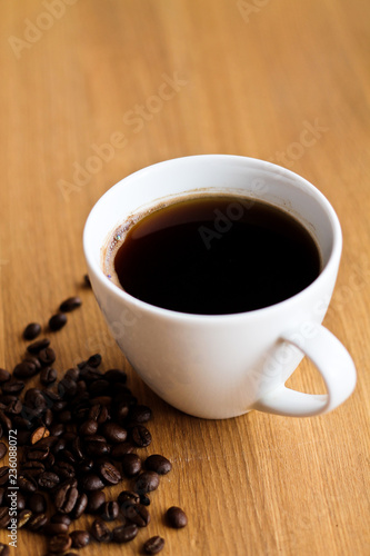 Foto op Canvas Chocolade Aromatic fresh coffee in porcelain cup on wooden table