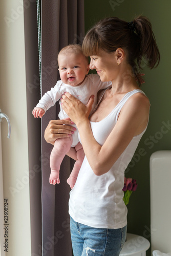 Fotobehang womenART happy mother and her cute baby